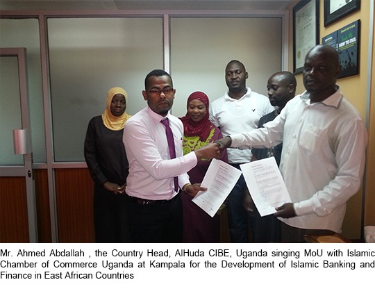 Mr. Ahmed Abdallah , the Country Head, AlHuda CIBE, Uganda singing MoU with Islamic Chamber of Commerce Uganda at Kampala for the Development of Islamic Banking and Finance in East African Countries